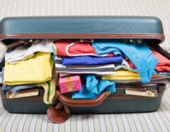 suitcase packed 350x272 - Τι θα περιέχει η βαλίτσα για το γαμήλιο ταξίδι